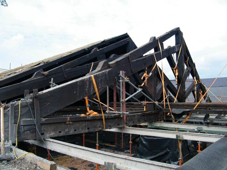 Roof trusses had slipped due to damp and wet rot.  Photo shows the trusses lifting into place, at First Derry Church, Londonderry, N. Ireland.