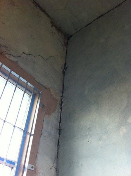Internal cracks in the walls were visible in the masonry; cracks were evident at the junction between the internal masonry walls and the external walls, caused by insufficient lateral restraint, Belfast, Co. Antrim, NI