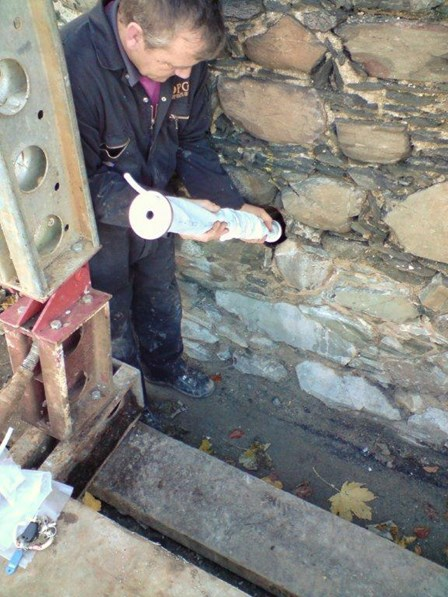 The grout is pressure pumped into the Cintec anchor at St Malachy's Wall, Bangor, Co. Down, NI.