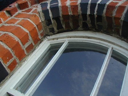 Replacement wall ties required.  Brickwork cracking around window arches, at Magilligan, Co. Derry, Northern Ireland