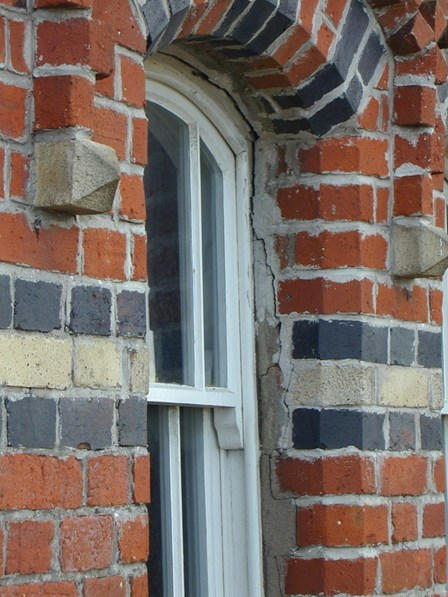 Replacement wall ties required.  Brickwork cracking around window arches, at Magilligan, Co. Londonderry, NI