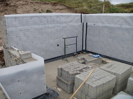Cavity drain basement waterproofing membrane mechanically fixed to blockwork retaining wall, at Co. Donegal, Ireland