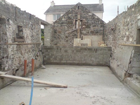 Barn portion of dwelling is partially a ground retaining structure; cavity drain basement waterproofing at Portrush, Co. Antrim, Northern Ireland, NI