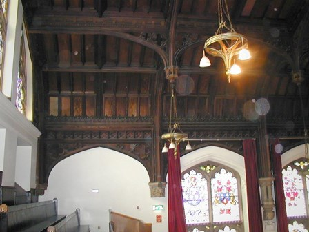The existing timber panelling and trusses, which were suffering from damp, wet & dry rot, and woodworm infestation at The Guildhall, Derry, NI