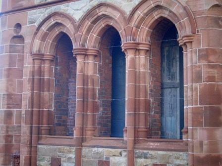 Bird wire in openings to bird proof against nuisance pigeons at The Guildhall, Derry, NI
