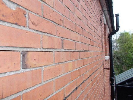 There is a vertical expansion of the bed joints, appearing as an horizontal crack in the external walls in this house in Belfast